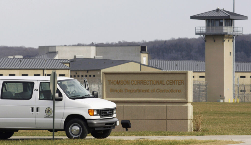 In this May 21, 2010, photo, a van drives past the Thomson Correctional Center in Thomson, Illinois.