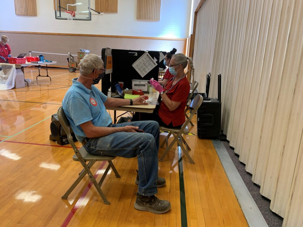 A phlebotomist prepares to draw blood from a volunteer. More than 6,000 people around the country have received blood donated by Latter-day Saints and friends of the faith in Colorado, Iowa and Nebraska.