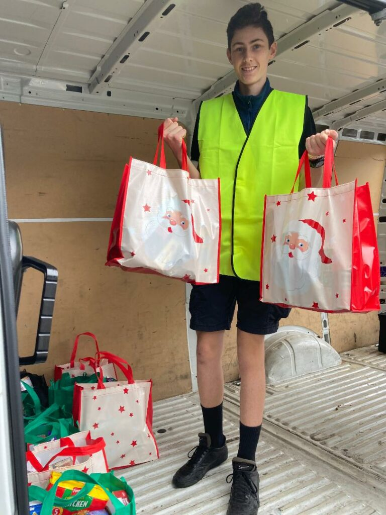 "Callum Winkworth, a priest from Queensland, Australia, participates in ""The Basket Brigade"" holiday service project facilitated by JustServe. Courtesy: Rhonda Winkworth"