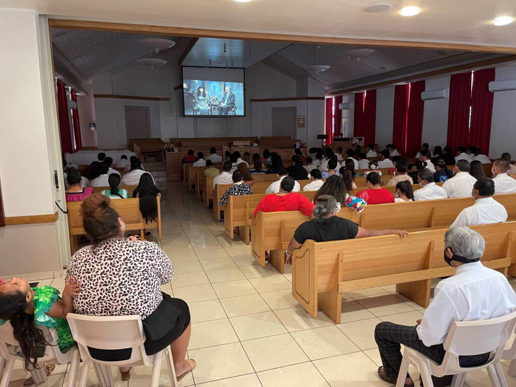 Young single adults in Tahiti listen to a broadcast by Elder Neil L. Andersen of the Quorum of the Twelve Apostles and his wife, Sister Kathy Andersen, on Sunday, Feb. 21, 2021.