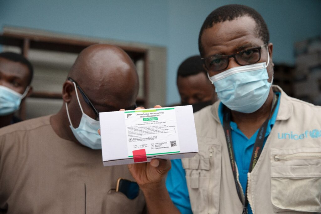 UNICEF staff show boxes containing the first shipment of COVID-19 vaccines distributed by the COVAX Facility in Accra, Ghana, on February 24, 2021.