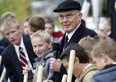 Elder Dallin H. Oaks of the Quorum of the Twelve stands with 12-year-old deacons from the Payson area he invited to take part in the ceremony as thousands turned out in the rain Saturday, Oct. 8, 2011, for the groundbreaking for the Payson Utah Temple.