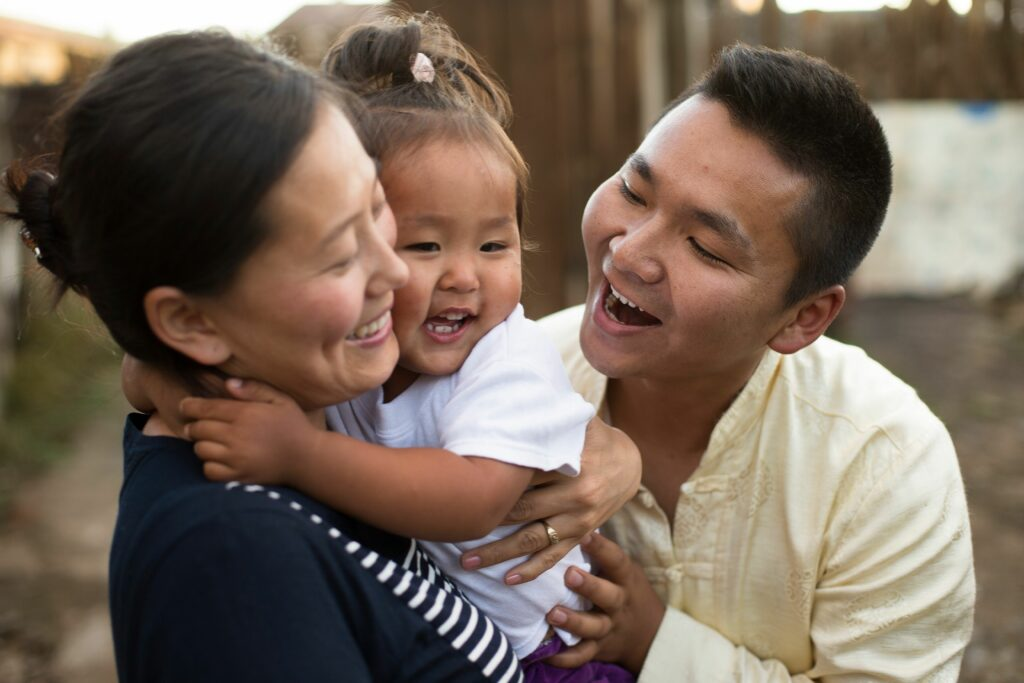 A young family in Mongolia laughs together in a happy moment. Several RootsTech Connect 2021 sessions emphasized the importance of connection.