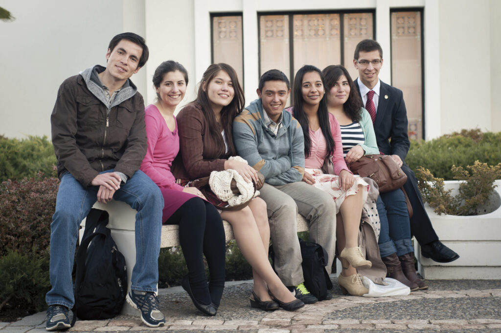 Youth gather outside the Santiago Chile Temple. Note: this picture was taken prior to the COVID-19 pandemic.