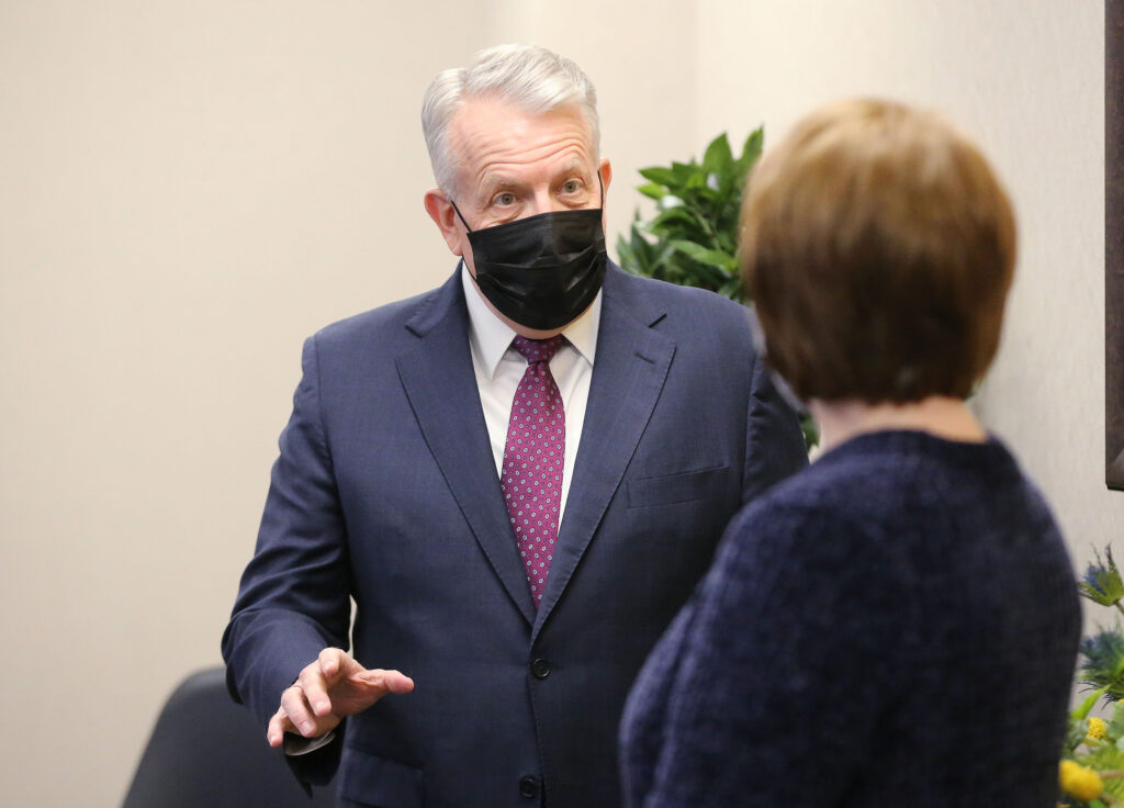 Elder Brent Nielson of the Presidency of the Seventy and Sister Sharon Eubank, first counselor in the Relief Society general presidency, prepare to participate in a devotional videoconference with young single adults from the Church Office Building in Salt Lake City on Sunday, March 7, 2021.