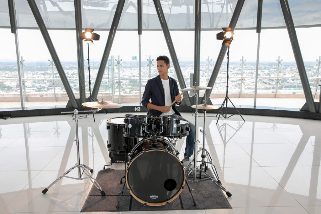 """A youth drummer in the Dominican Republic poses for a photo while recording """"Si Tú Lo Crees"""" (""""If You Believe"""") for the Youth Music Festival, which premiered on Wednesday, March 17, 2021."""