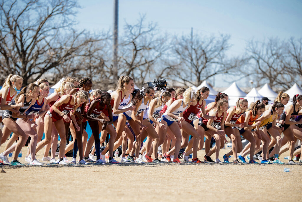 BYU cross country runners surge across the start line at the NCAA championships on Monday, March 15th 2021 in Stillwater, Oklahoma. The Cougars won the team competition.