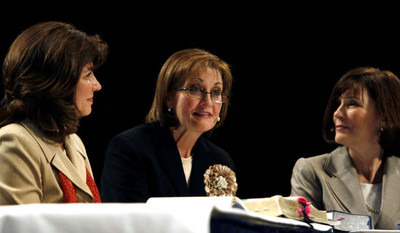 Relief Society general presidency members from left, Carole M. Stephens, Linda K. Burton, president, and Linda Reeves, speak at the BYU Women's Conference in the Marriott Center on the BYU Campus in Provo on Thursday, April 26, 2012
