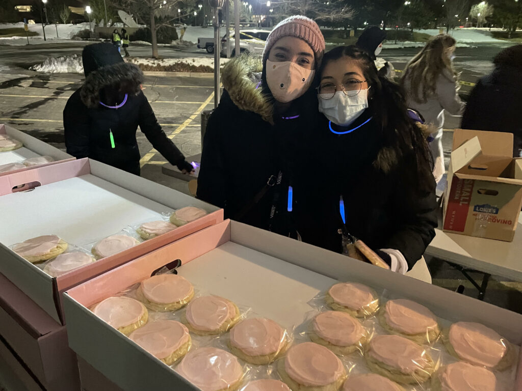 Two young single adults participate in the service project that took place as part of a two-day event held for young single adults in the North Salt Lake area Feb. 20-21, 2021.
