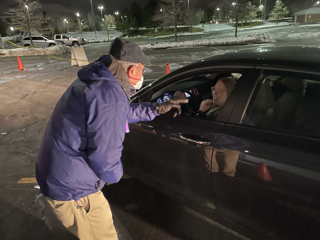 Elder Gerrit W. Gong greets young single adults as they donated socks as part of the service project that took place as part of a two-day event held for young single adults in the North Salt Lake area Feb. 20-21, 2021.