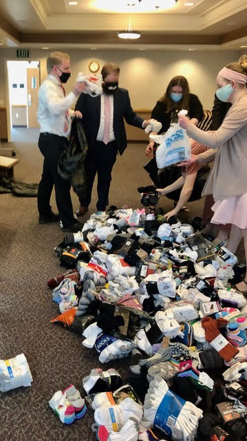 Young single adults organize donations for local homeless shelters during the service project that took place as part of a two-day event held for young single adults in the North Salt Lake area Feb. 20-21, 2021.