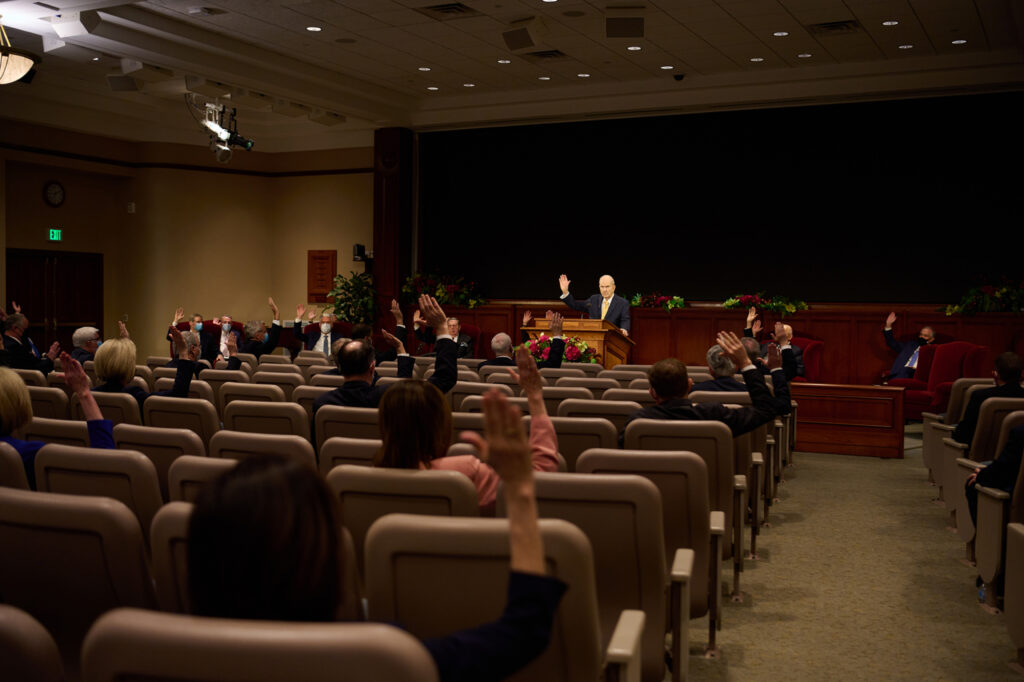 President Russell M. Nelson calls for a sustaining vote for 77 new Area Seventies during a leadership meeting at the Church Office Building auditorium on Thursday, April 1, 2021.