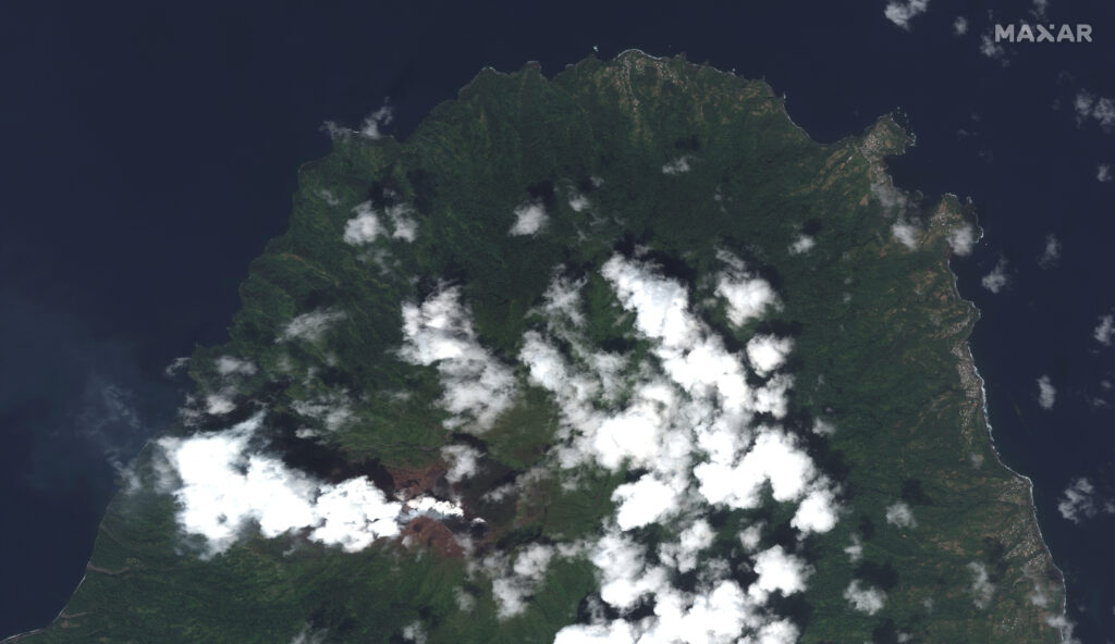 This image provided by Maxar Technologies shows La Soufriere volcano on the Caribbean island of St. Vincent, Thursday, April 8, 2021, the day before it erupted.