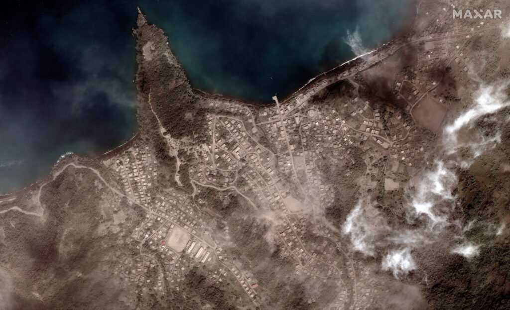 This image provided by Maxar Technologies shows the Richmond Vale waterfront covered in volcanic ash, in Chateaubelair, St. Vincent, Tuesday, April 13, 2021, a day after after another eruption of the La Soufriere volcano. St. Vincent is the biggest of the islands forming St. Vincent and the Grenadines, which gained independence from Britain in 1979 and has a population of about 110,000.