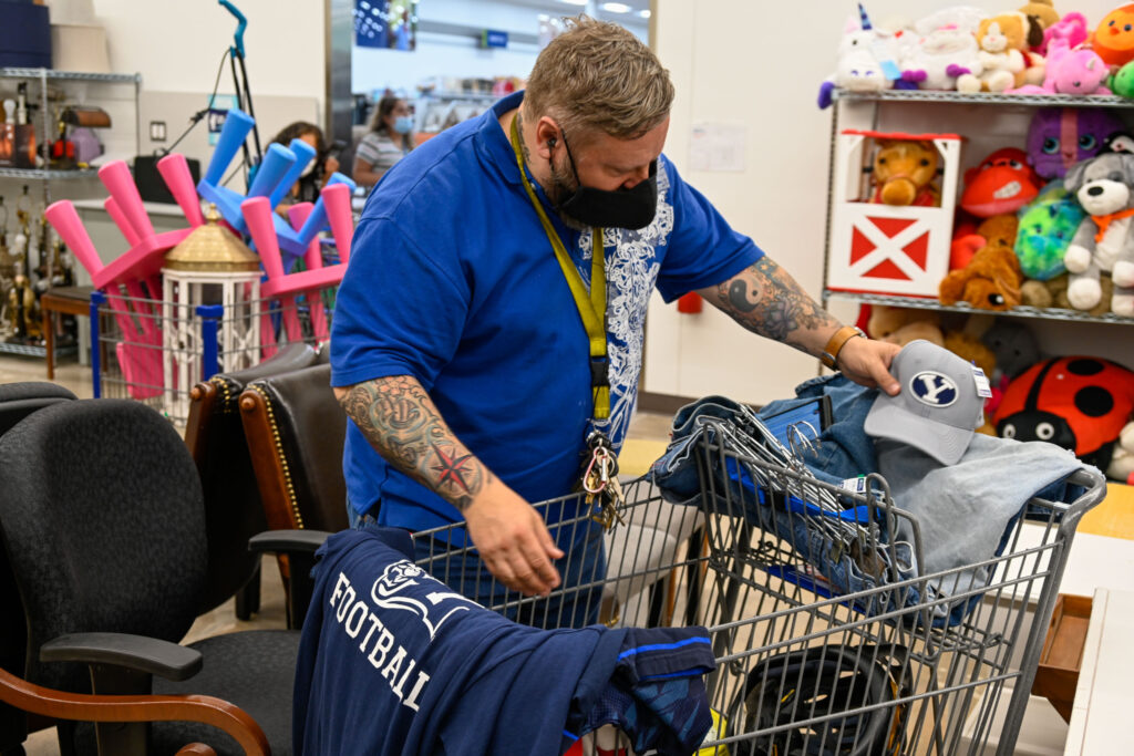 Alex Wathen shops at the new Deseret Industries in Houston, Texas. The thrift store opened to the public on April 15, 2021.