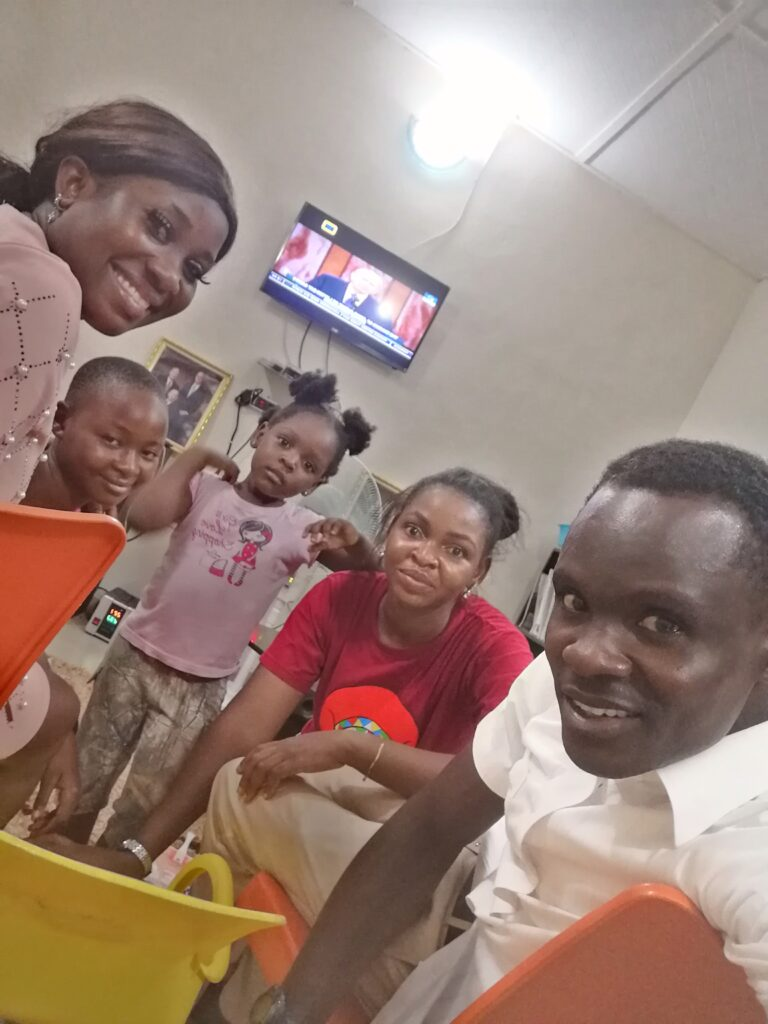 The Okpokam family — Okpokam Okpokam, Christiana, Anor-Osowo, Beauty and Priscilia Eneobong — of the Ikot Eneobong Ward, Calabar Nigeria North Stake, watch the Sunday morning session of the 191st Annual General Conference on April 4, 2021.