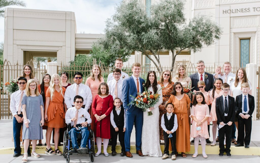 The McKendrick family is pictured at Ian and Janae McKendrick's wedding at the Gilbert Arizona Temple in October 2020. This photo includes 20 of the 24 McKendrick children, two daughters-in-law and four grandchildren.