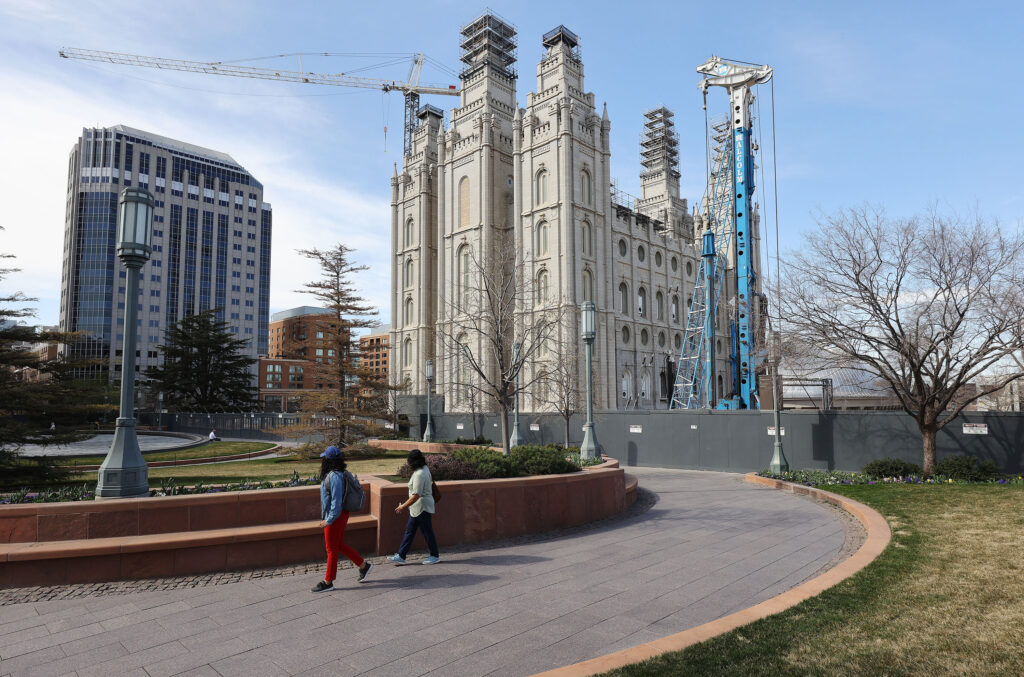 Visitors walk near the Salt Lake Temple during the 191st Annual General Conference of The Church of Jesus Christ of Latter-day Saints in Salt Lake City on Sunday, April 4, 2021.