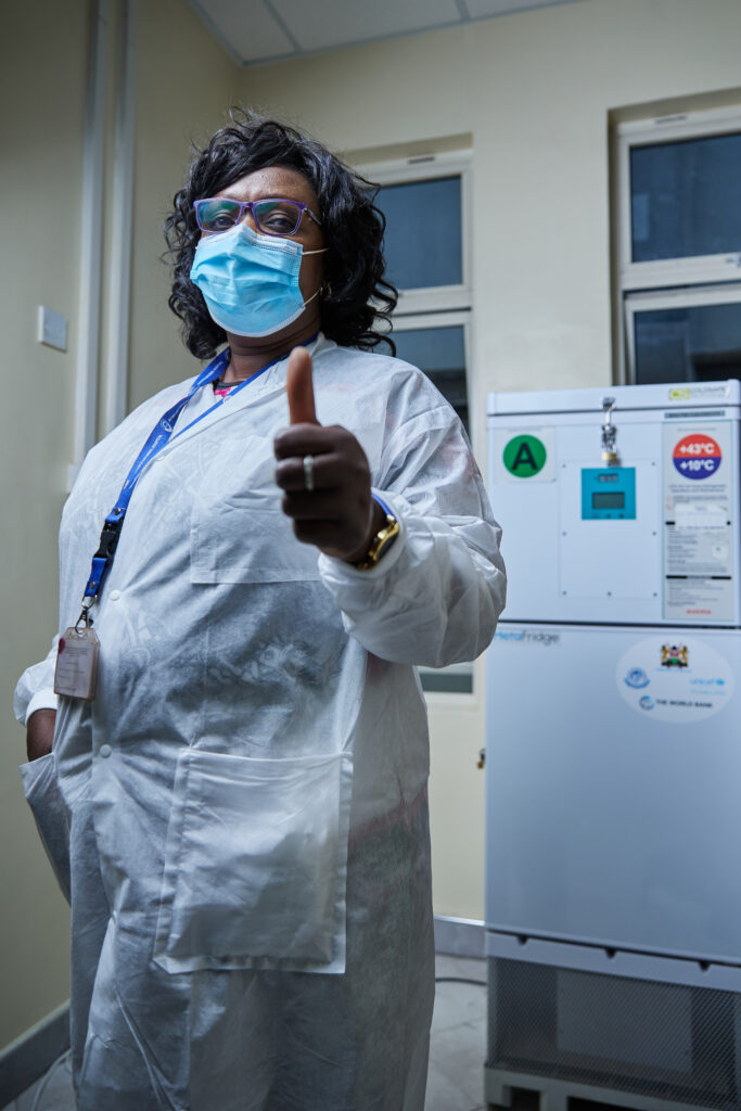 """Jerusha, a nurse at Kenyatta National Hospital, received the COVID-19 vaccine at the hospital in Nairobi, Kenya, on March 5, 2021. She says: """"I'm glad the vaccine is here and I feel safe. I would tell my fellow health workers to get vaccinated. We are on the front line and need to be protected from COVID-19."""" The COVAX initiative plans to provide at least 2 billion doses of COVID-19 vaccines to low- and lower-middle-income countries by the end of 2021."""