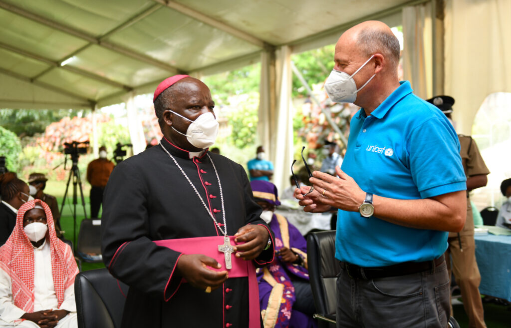 """UNICEF Malawi Representative Rudolf Schwenk with Archbishop Thomas Msusa of the Archdiocese of Blantyre, Malawi. After getting the COVID-19 vaccine, the archbishop said: """"I am a very excited Malawian today. I have been encouraging my church members to receive this vaccine when it comes. You know God answers in different ways, and I believe this vaccine is an answer to our cry and prayers to God."""""""
