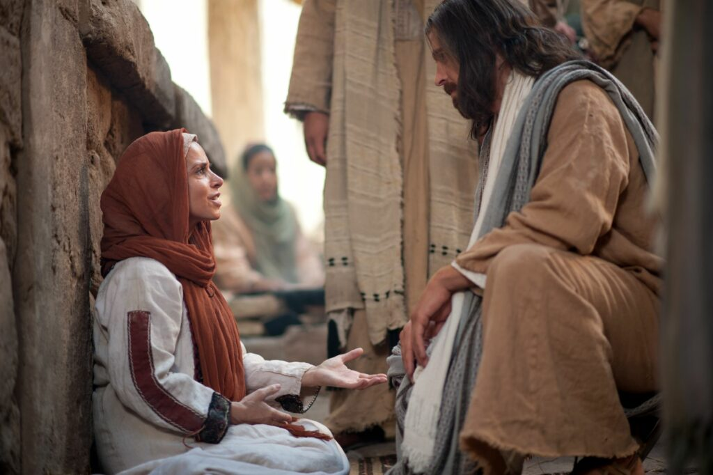 In scene depicted in Bible videos published by The Church of Jesus Christ of Latter-day Saints, Jesus ministers to a woman. Elder Holland told students at Utah State University on April 23, 2021, that perfect leadership is exemplified by the Savior Jesus Christ.