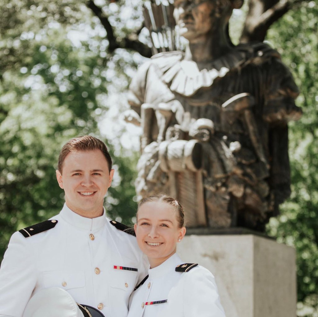 """U.S. Naval Academy midshipmen Mason Wells and Cassidy Hylton pose on the """"yard"""" of the service academy in Annapolis, Maryland. The two will marry soon after their May 28, 2021, graduation and commissioning."""