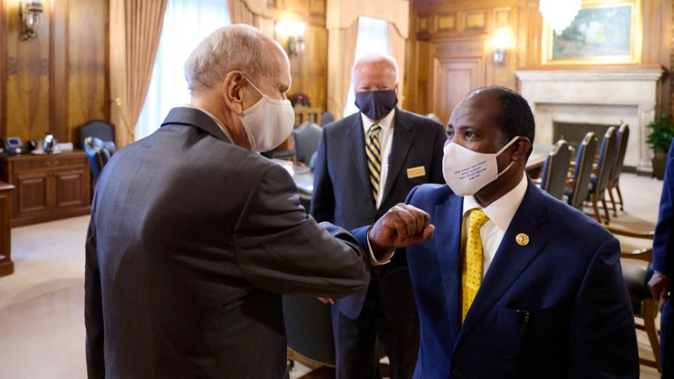 President Russell M. Nelson , left, and Secretary General Tiguhan Kesis Tagay Tadele bump elbows at the beginning of the Ethiopian leader's meeting with The Church of Jesus Christ of Latter-day Saints' First Presidency on Wednesday, May 5, 2021, in Salt Lake City.