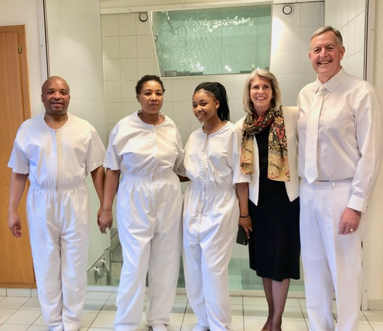 Sister Carol F. McConkie and Elder Oscar W. McConkie's visit with the ambassador of Lesotho, Refiloe Litjobo, led to him and his family being baptized. Refiloe, left, his wife, Makananelo, and their daughter Kananelo were baptized March 8, 2020.