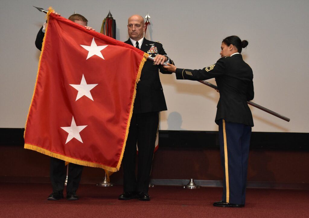 Newly promoted U.S. Army Lieutenant General Neil Thurgood, a Latter-day Saint, accepts a three-star flag during the April 24, 2019, promotion ceremony.