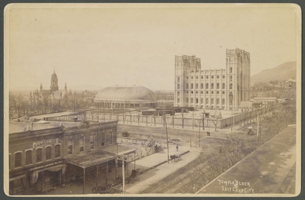 A photograph taken in 1890 by Charles Roscoe Savage from the roof of ZCMI on Main Street in Salt Lake City, shows Temple Square including the Salt Lake Temple under construction, the Salt Lake Tabernacle and the Assembly Hall.
