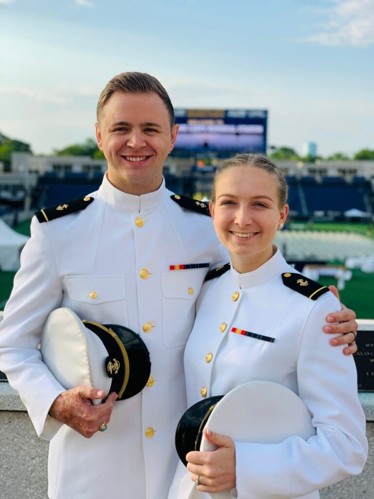 Newly commissioned U.S. Navy ensigns Mason Wells and his fiancee, Cassidy Hylton, enjoy a moment together prior to the May 28, 2021, graduation ceremony at the United States Naval Academy. The two are planning to marry in the June before embarking on their respective military careers.
