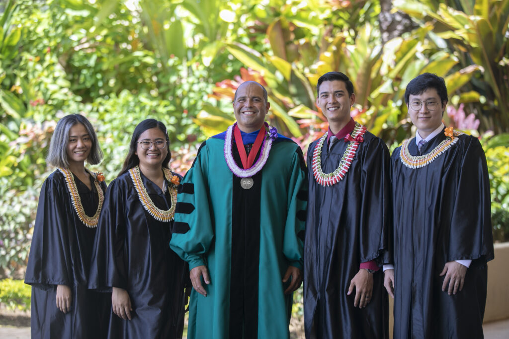 BYU–Hawaii President John S.K. Kauwe III poses with graduates prior to the spring commencement ceremony broadcast on Saturday, June 26, 2021.