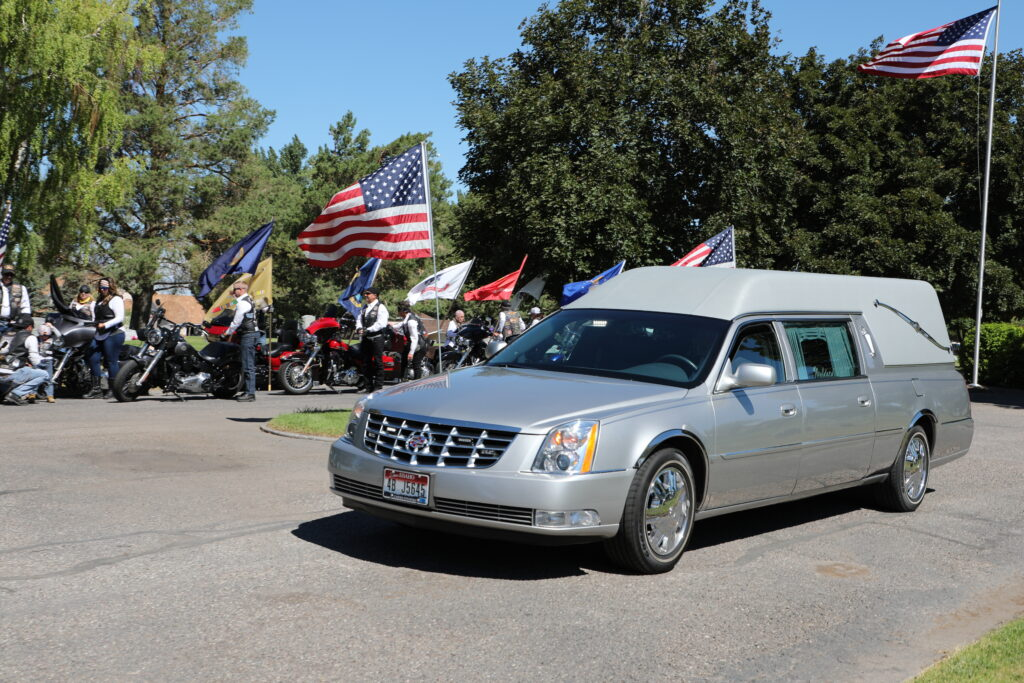 Patriot Guard Riders from Idaho stand watch over the hearse carrying the remains of Navy Fireman 2nd Class Carl M. Bradley, who died at Pearl Harbor 80 years ago on the U.S.S. Oklahoma. After an eight-decade wait, the Defense POW/MIA Accounting Agency under the Department of Defense identified the sailor's remains through family DNA. He was interred Saturday, June 26, 2021, at the cemetery in his hometown, Shelley, Idaho.