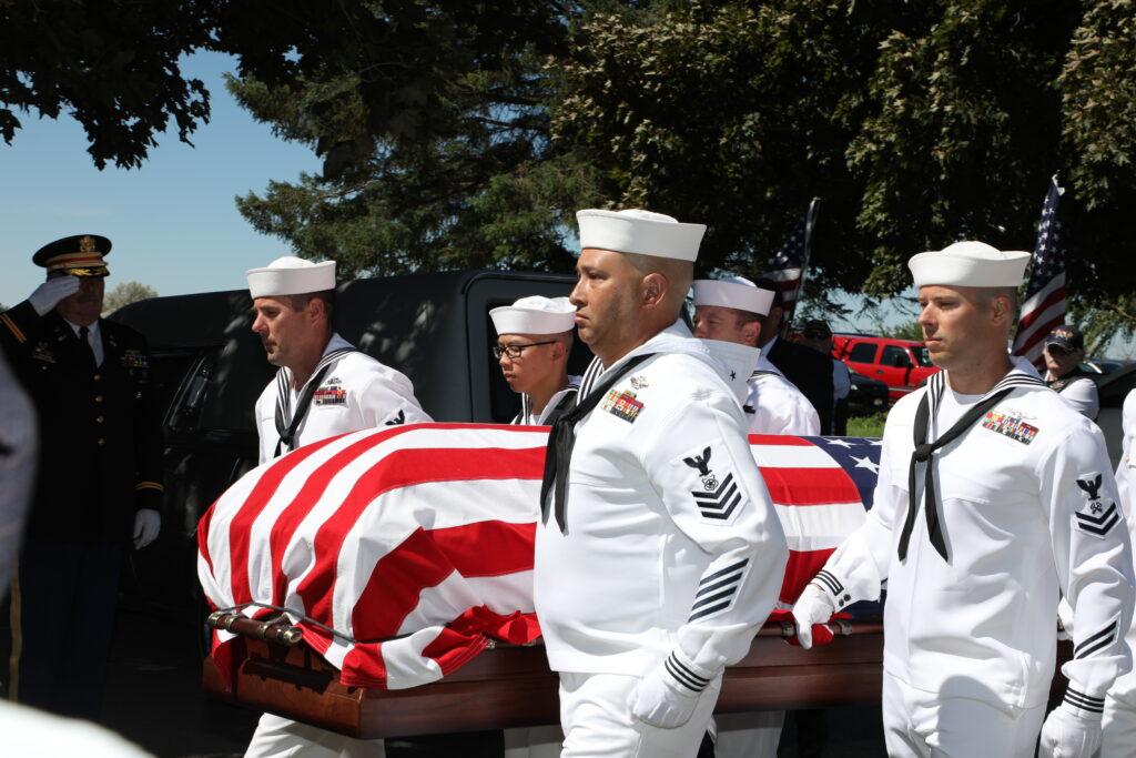 A U.S. Navy Honor Guard bears the casket of Navy Fireman 2nd Class Carl M. Bradley, who was 19 on Dec. 7, 1941, during the attack on Pearl Harbor. He was among more than 400 killed on board the U.S.S. Oklahoma but whose remains were interred in the National Memorial Cemetery of the Pacific until DNA research allowed his family to return him home 80 years later for burial in Shelley, Idaho. The services were June 26, 2021.