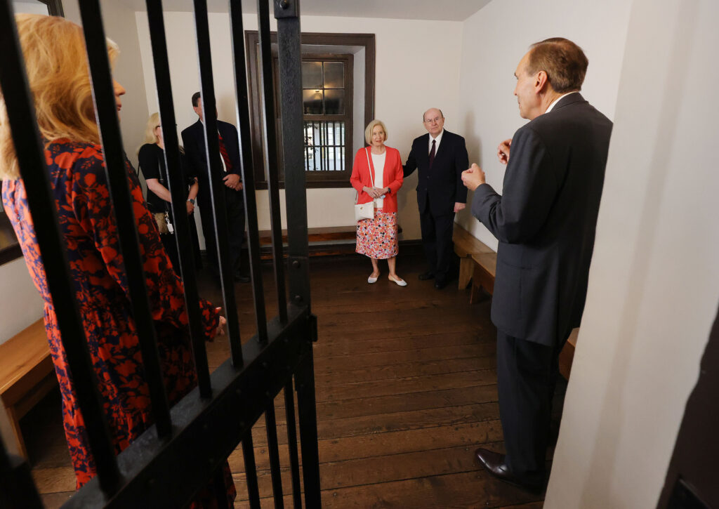 Elder Quentin L. Cook of the Quorum of the Twelve Apostles of The Church of Jesus Christ of Latter-day Saints, with his wife, Sister Mary G. Cook, tour the historic Carthage Jail in Carthage, Illinois, on Friday, May 28, 2021.