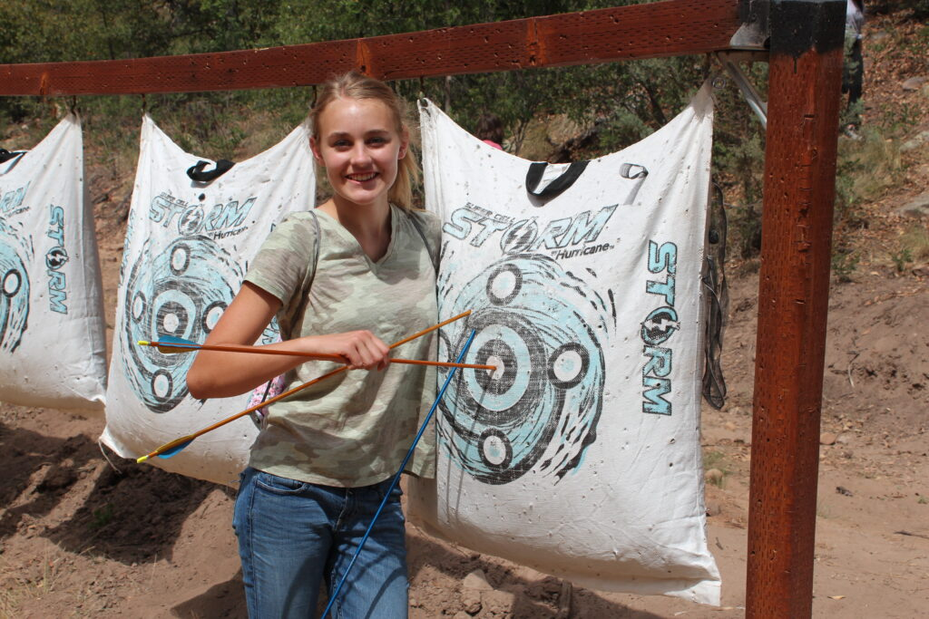 Tiarra Cirks of the Queen Creek Arizona South Stake nails a bull's-eye in an archery class during a Young Women camp at Camp LoMia near Pine, Arizona, on June 3, 2021.
