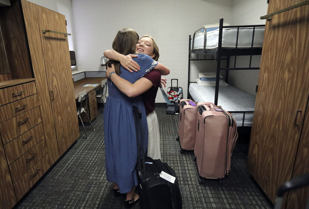 Sister Amberly Morrow, from Farmington, Utah, hugs Sister Madalyn Dever, from Lehi, Utah, in their room at the Provo Missionary Training Center in Provo on Wednesday, June 23, 2021. Both will be serving in the New Jersey Morristown Mission.