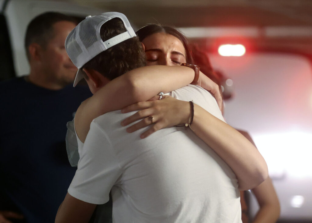 Sister Aubrey Calderwood gives her brother Cody Calderwood a goodbye hug as her family drops her off at the Provo Missionary Training Center in Provo on Wednesday, June 23, 2021.