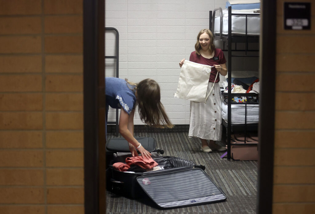 Sister Amberly Morrow, from Farmington, Utah, and Sister Madalyn Dever, from Lehi, Utah, unpack their suitcases in their room at the Provo Missionary Training Center in Provo on Wednesday, June 23, 2021. Both will be serving missions in the New Jersey Morristown Mission.