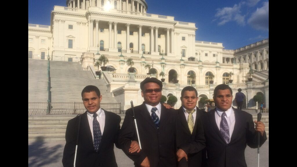 Ollie Cantos, and his sons, Nick, Steven and Leo, in front of the U.S. Capitol in Washington D.C.