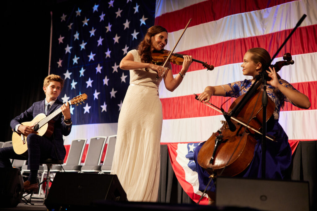 Jenny Oaks Baker and Family Four perform a musical number during the annual Freedom Awards Gala, an event of America's Freedom Festival at Provo, Utah, on July 1, 2021.