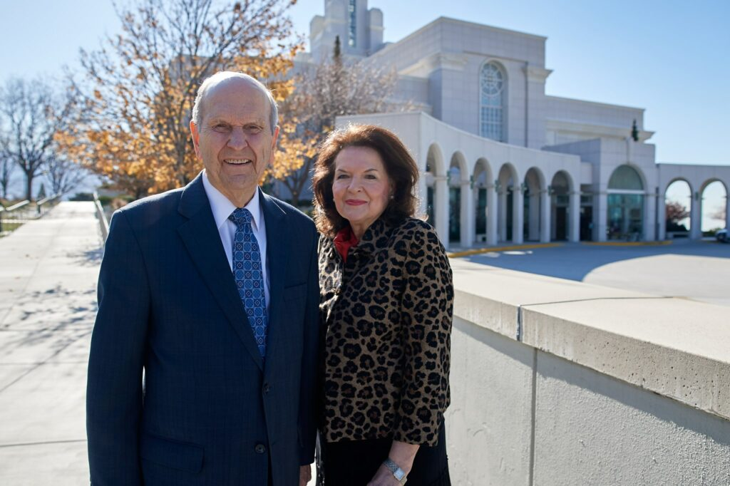 President Russell M. Nelson, President of the Church, and his wife, Wendy Nelson, stand in front of the Bountiful Utah Temple. President Nelson encouraged members in a social media post on July 5, 2021 to celebrate the reopening of all temples to some level of operations.