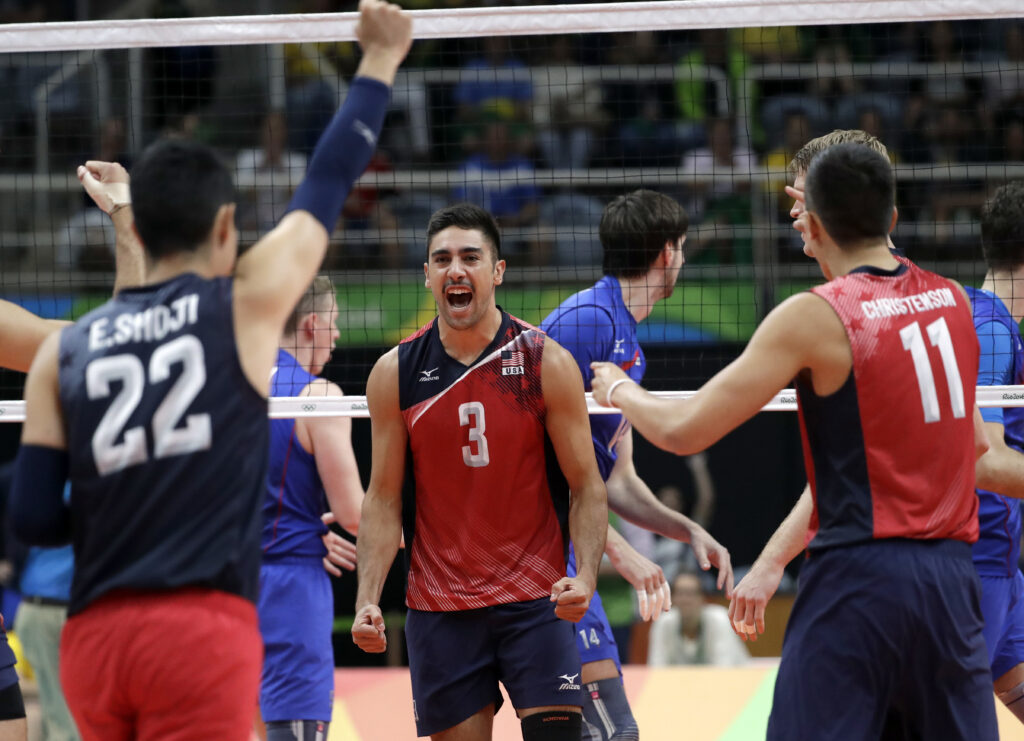 United States' Taylor Sander (3) celebrates with teammates Erik Shoji (22) and Micah Christenson (11) during a men's bronze medal volleyball match against Russia at the 2016 Summer Olympics in Rio de Janeiro, Brazil, Sunday, Aug. 21, 2016.