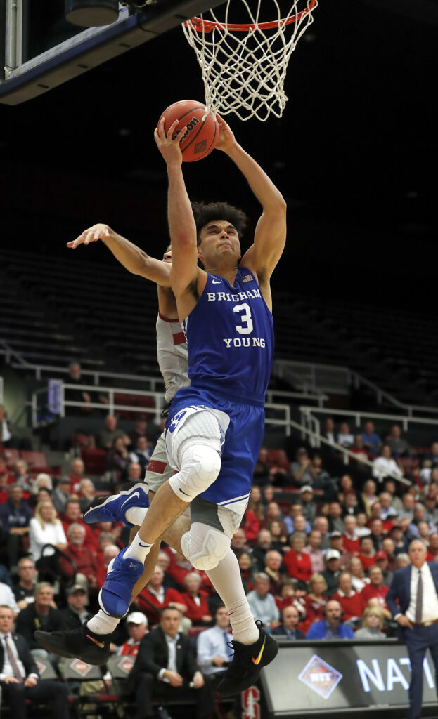 BYU guard Elijah Bryant (3) drive to the basket against Stanford guard Dorian Pickens during the second half of an NCAA college basketball game in the first round of the NIT, Wednesday, March 14, 2018, in Stanford, Calif. (AP Photo/Tony Avelar)