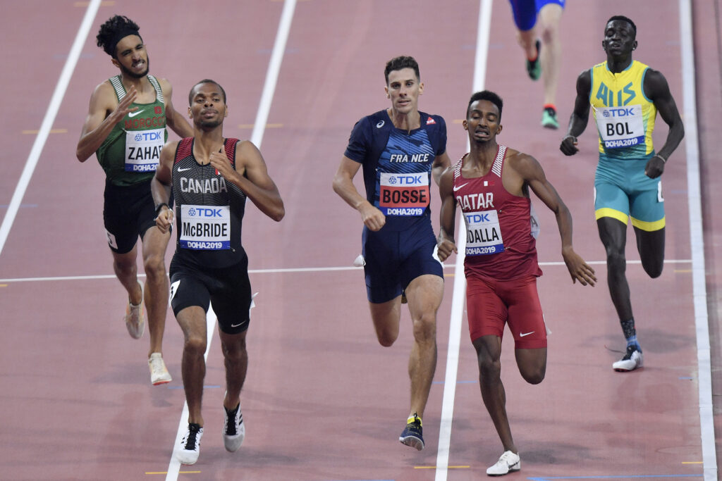 Peter Bol, of Australia, right, and, from left, Mouad Zahafi, of Morocco, Brandon Mcbride, of Canada, Pierre-Ambroise Bosse, of France,and Abubaker Haydar Abdalla, of Qatar, compete in a men's 800 meter race heat during the World Athletics Championships in Doha, Qatar, Saturday, Sept. 28, 2019.