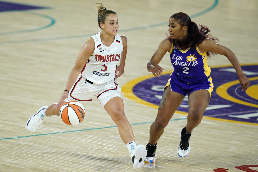 Washington Mystics guard Leilani Mitchell, left, dribbles next to Los Angeles Sparks guard Te'a Cooper (2) during the first half of a WNBA basketball game Thursday, June 24, 2021, in Los Angeles.