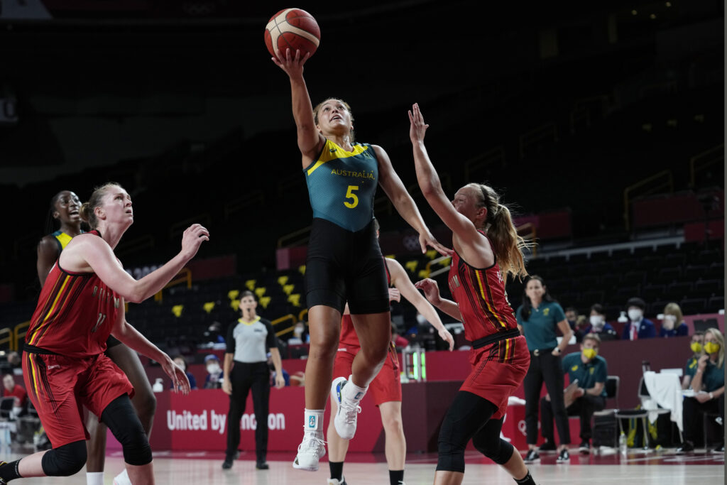 Australia's Leilani Mitchell (5) drives past Belgium's Julie Allemand, right, during a women's basketball game at the 2020 Summer Olympics, Tuesday, July 27, 2021, in Saitama, Japan.