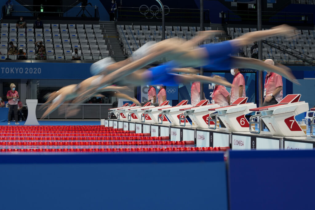 Swimmers start a heat of the men's 200-meter breaststroke at the 2020 Summer Olympics, Tuesday, July 27, 2021, in Tokyo, Japan.