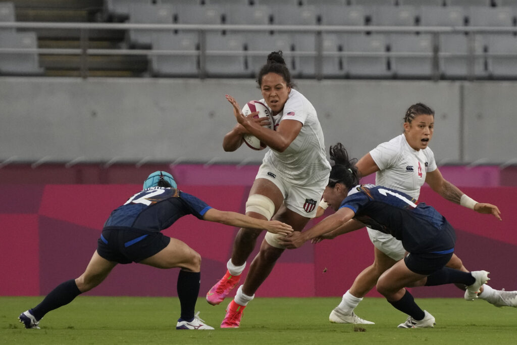 Jordan Matyas (8) of the United States tries to break through Japan's Honoka Tsutsumi, left, and Japan's Mifuyu Koide in their women's rugby sevens match at the 2020 Summer Olympics, Thursday, July 29, 2021 in Tokyo, Japan.