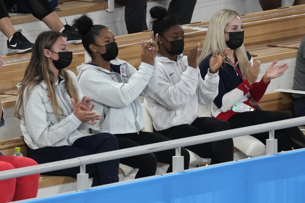 From left, United States' gymnast Grace McCallum, Jordan Chiles, Simone Biles and MyKayla Skinner celebrate after teammate Sunisa Lee won the gold medal for the artistic gymnastics women's all-around final at the 2020 Summer Olympics, Thursday, July 29, 2021, in Tokyo.